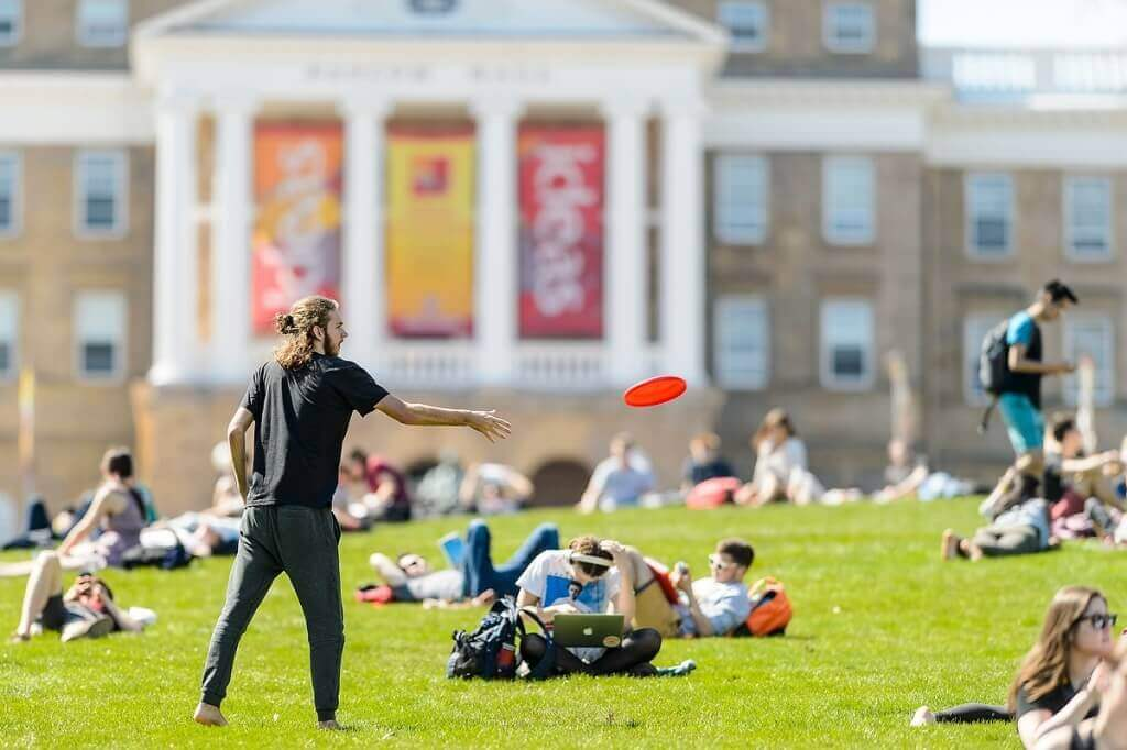 Photo: Person throwing Frisbee on Bascom Hill