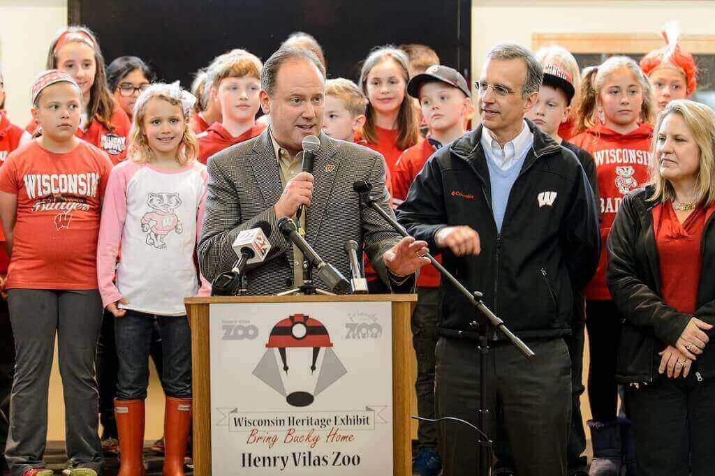 Surrounded by representatives of the Henry Vilas Zoo and the Madison community, UW basketball coach Greg Gard speaks at a press conference announcing the