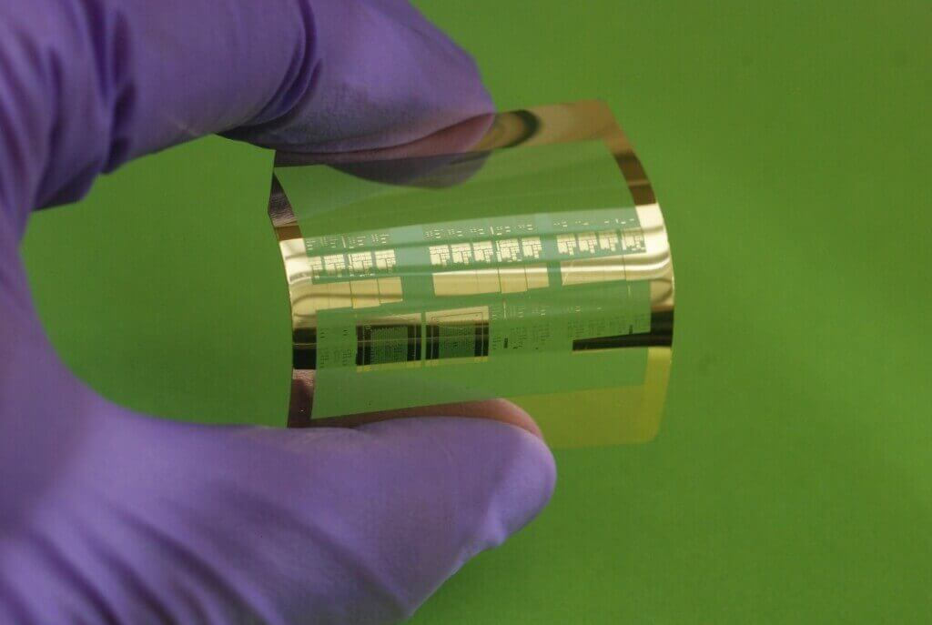 Photo: Flexible transistor held in gloved hand