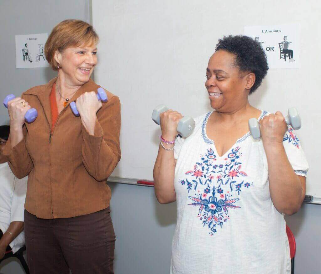 Kim Gretebeck, assistant professor of nursing at UW–Madison, and Pamela Bracey demonstrate the exercise program Gretebeck has developed for senior citizens.