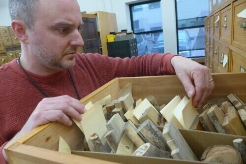 Alex Wiedenhoeft inspects samples in the world's largest research wood collection at the U.S. Forest Products Lab, with samples from about 20,000 species of woody plants.