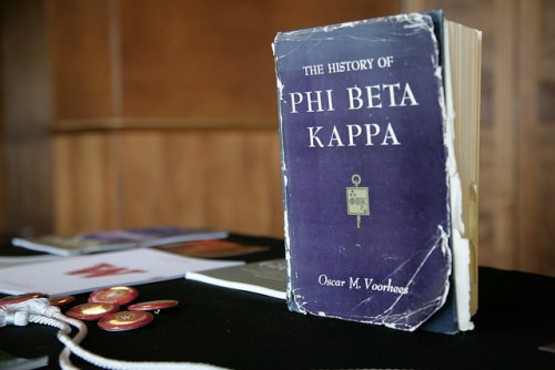 A well-thumbed book of Phi Beta Kappa history welcomes new initiates and their families to the 2016 spring banquet.