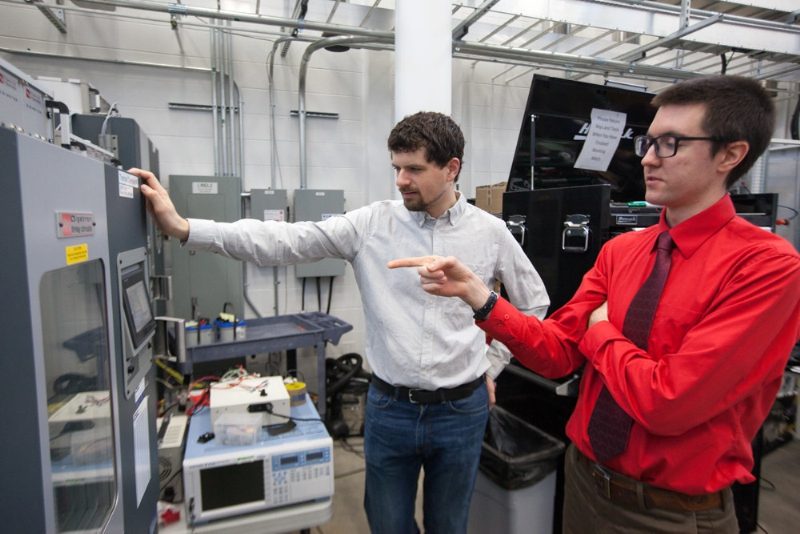 Johnson Controls Fellows Kevin Frankforter (left) and Jacob Dubie are pictured in the Johnson Controls Energy Storage Research Lab at the Wisconsin Energy Institute on the UW–Madison campus. (Photo by Matthew Wisniewski)
