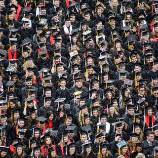 Orderly rows of graduates covered the football field in Camp Randall.