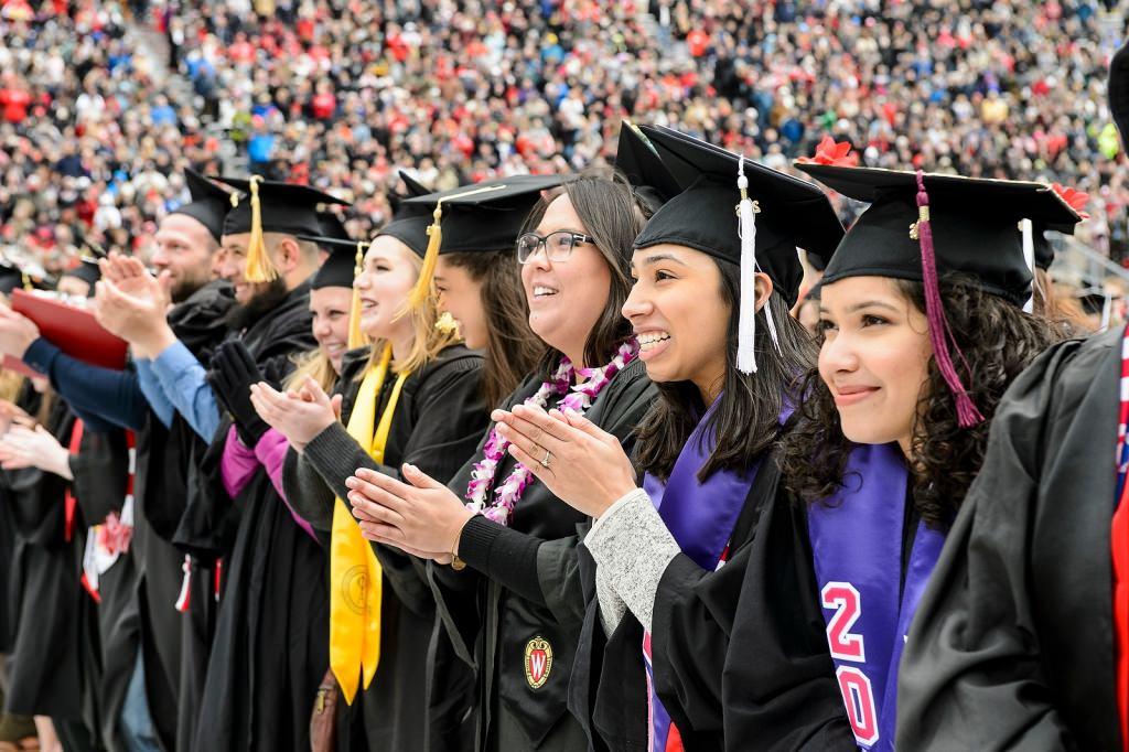 Graduates celebrate as they sing Varsity.