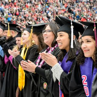 Graduates celebrate during commencement exercises at Camp Randall Stadium in May 2016.
