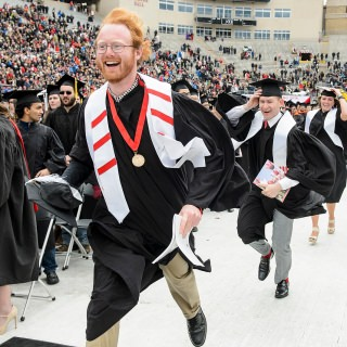 Graduates run towards the future after the event ends, marking the end of this phase of their lives.