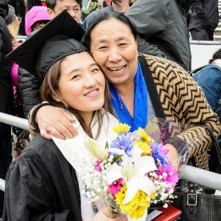 Graduate Tenzin Pema celebrates with her family.