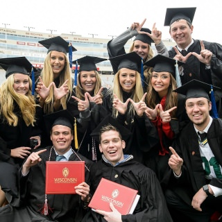 A group of friends celebrates their transition from students to Badger alumni.