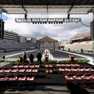 Staff make final preparations for the Camp Randall ceremony Saturday morning.