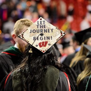 Graduates put their creativity on display with decorated mortarboards during Friday's ceremony.