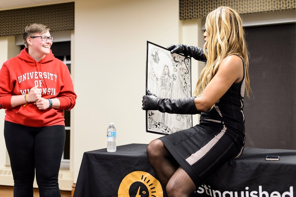 Photo: Student presenting Laverne Cox with poster