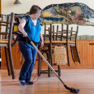 """Lynne Dalka is responsible for independently maintaining and cleaning seven diverse buildings — from labs to residence halls — at the Kemp Natural Resources Station in far northern Wisconsin. Rather than being daunted, Dalka has mixed old-fashioned elbow grease with innovation, adopting environmentally friendly cleaners and more efficient tools to keep the facility in top condition for the hundreds of scientists, students, faculty and natural resource professionals who visit each year. Her conscientiousness extends to frequent birthday cakes, shared vegetables from her farm, and wide involvement with her church and community. Karla Ortman, Dalka's nominator, says: """"Lynne is an outstanding ambassador for the university in the northern reaches of the state."""""""