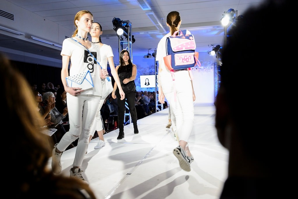 A proud designer follows her textile creations in a final walk down the runway.