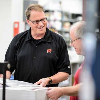 """Some of DoIT's most popular annual charity events — the Chili Cook-Off, the Costume Contest and the Mini Golf tournament — are all thanks to a printing supervisor who's built a reputation for encouraging and supporting his staff.  Rich Gassen is also active in promoting University Staff Shared Governance. Jake Rebholz, who nominated Gassen, says of him: """"I have always found him to be one of the most positive, productive and effective employees at this university. If he doesn't deserve this award, I'm not sure who does."""""""