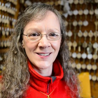 """When a chilled water coil broke on a Sunday at the School of Veterinary Medicine last year, Karen Mier jumped into action. On call 24 hours a day, she started on all the hard work that came after the flood stopped: working with custodial, trades and risk management staff, along with many external contractors, to restore offices and research space.  Her diligence earned her the trust of her coworkers. """"Eight hundred faculty, staff and students who use the School of Veterinary Medicine buildings every day don't have to worry about the reliable and secure operations because they know Karen has it covered,"""" says Kristi Thorson, who nominated her. Outside her job, Mier has raised thousands of dollars to provide bullet- and stab-proof vests for K-9 officers and supports a Golden Retriever rescue."""