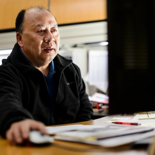 """Jzong Thao came to the United States in 1981 as a refugee who spoke very little English; by 1991, he had graduated from UW-Madison with a finance and marketing degree. His work at the Office of Human Resources as a Hmong-English translator, interpreter and trainer in Cultural Linguistic Services is helping hundreds of others advance their English skills with the help of a tutoring program he established. Thao teaches citizenship classes to Hmong elders in Madison and is active in the community, including coaching youth soccer. As Carmen Romero González, who nominated him for the award, puts it: """"He is a vivid example of a hardworking person."""""""