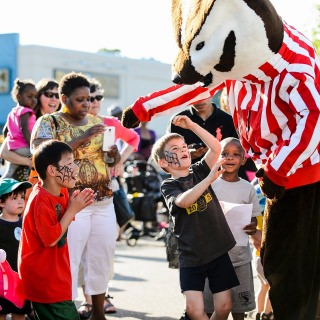 Young boys are excited to meet UW–Madison mascot Bucky Badger.