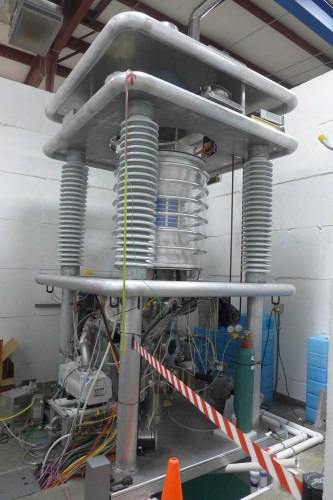 Big white machine with curved layers and coil-like supports