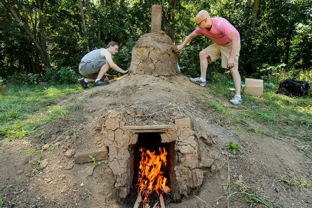 Photo: Students sealing cap of burning kiln