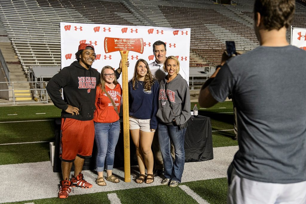 Photo: Corey Clement, Paul Chryst and fans posing for picture