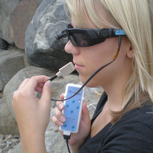 Photo: Woman demonstrating vision aid system