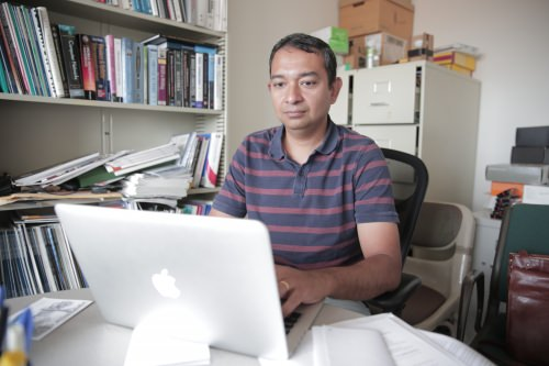 Suman Banerjee at his computer.