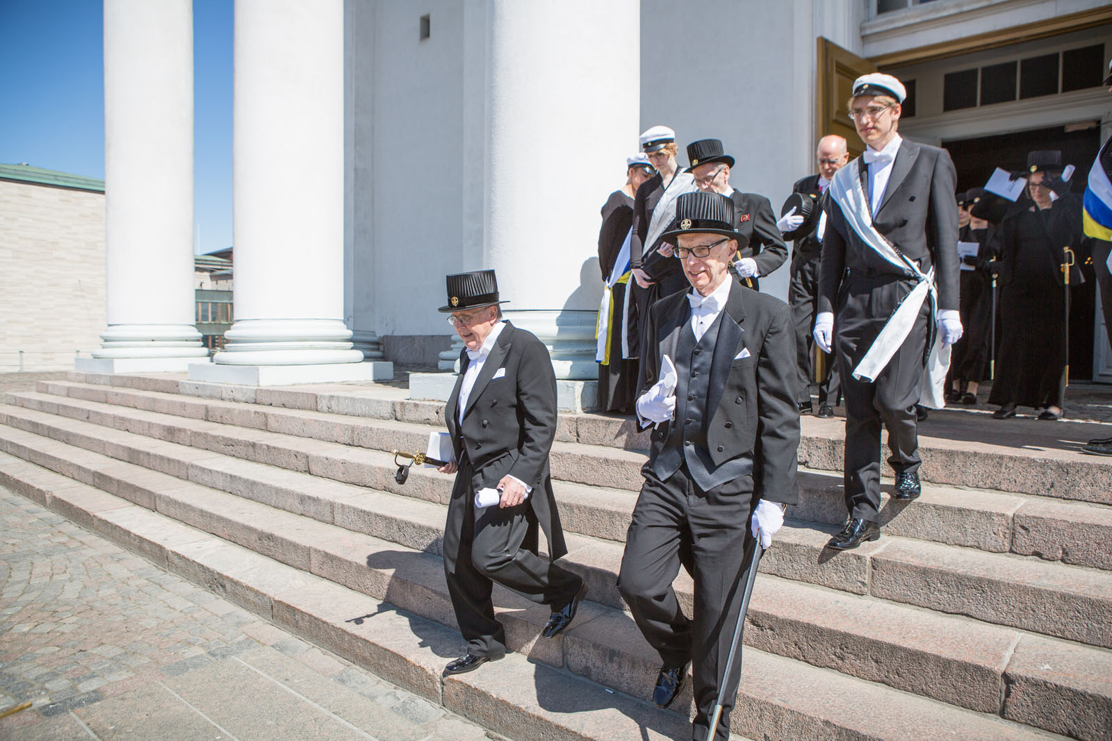 Sociology Professor Douglas Maynard, center, leaves the Great Hall at the University of Helsinki after receiving an honorary doctorate. (Photo: Mikka Verto)