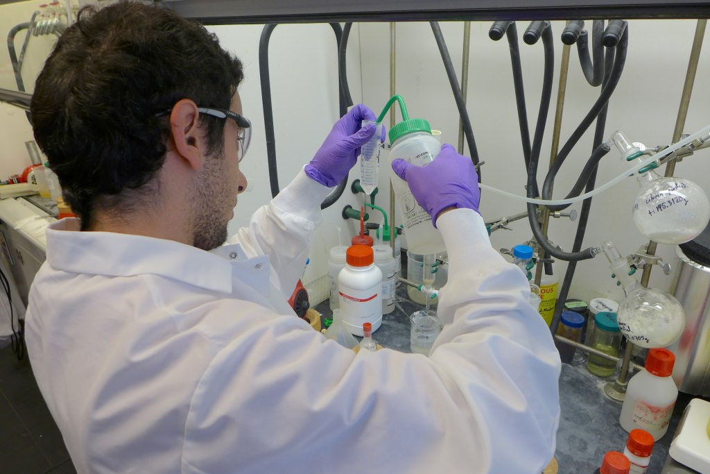 Photo: Alex Amatuni, a UW–Madison intern, performs a chemical synthesis at Arrowhead