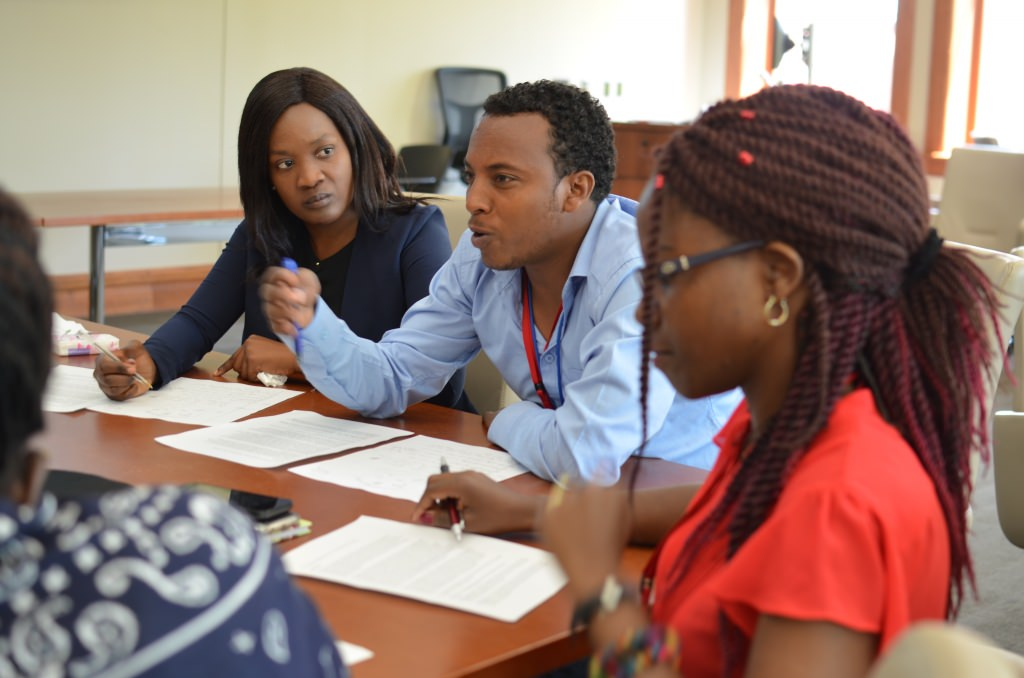 During an August 2016 session, Mandela Washington Fellows speak up during a constitution-making simulation with UW–Madison professor Heinz Klug.