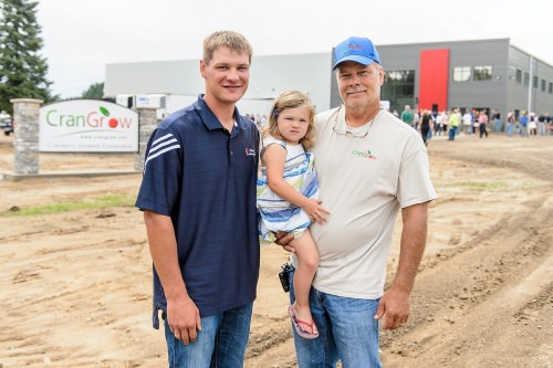 Adam Nemitz, daughter TK and father Robert represent three generations of cranberry growers near Warrens, Wisconsin. The Crangrow cooperative in Warrens, just down the road from their marshes, celebrated its grand opening Aug. 11, 2016.