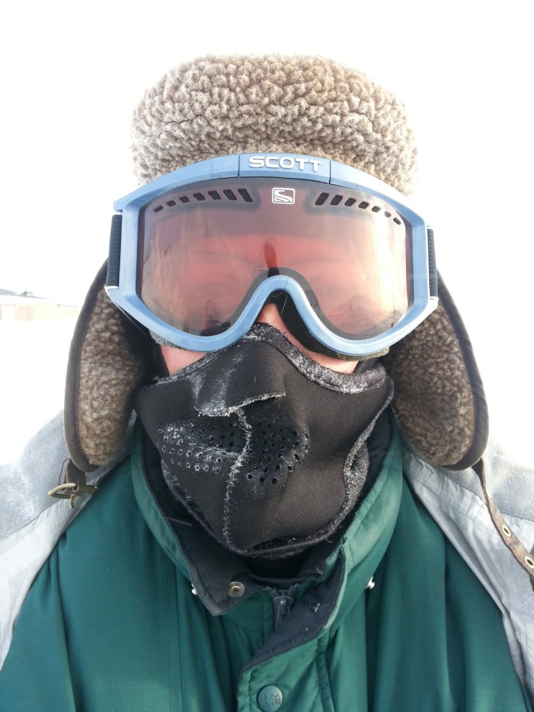 Jack Williams is bundled up to protect against extreme cold and wind during a winter season in the field on polar St. Paul Island.