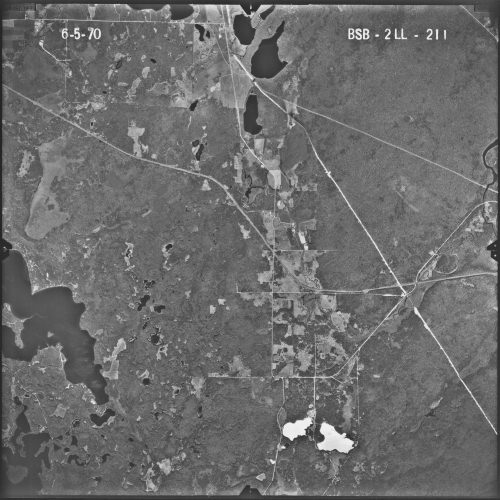 "The scar from the Nov. 18, 1966, crash of an Ari Force B-52 bomber is still visible — near the horizontal centerline of the image, directly down from the ""2LL"" mark in the upper right — in this aerial photo taken in June of 1970."