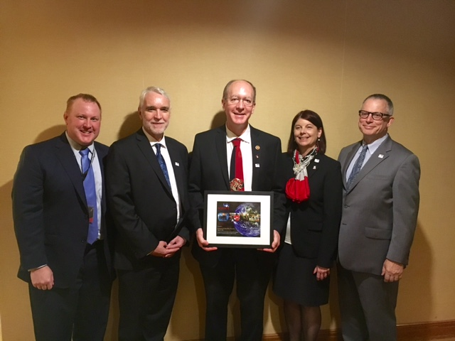 U.S. Rep. Bill Foster, center, receives The Science Coalition's Champion of Science award Monday at the International Conference on High Energy Physics in Chicago. Also pictured are, from left, Ben Miller, UW–Madison director of federal relations; Tim Killeen, president of the University of Illinois; Lisa Freeman, Northern Illinois University executive vice president and provost; and Bruce Layton, Northwestern University special assistant to the president for government relations.