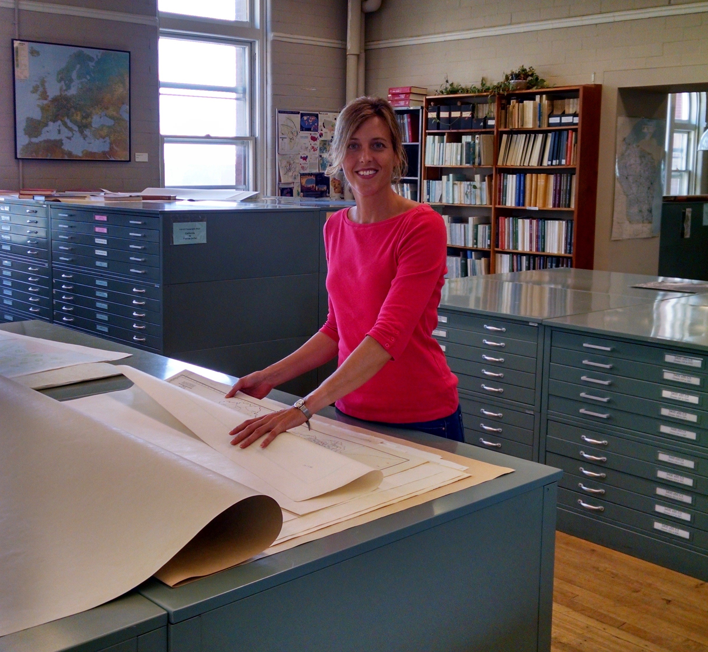 Jaime Stoltenberg, map and geospatial data librarian in the Department of Geography, is picutured in the Arthur H. Robinson Map Library in Science Hall at the UW–Madison.