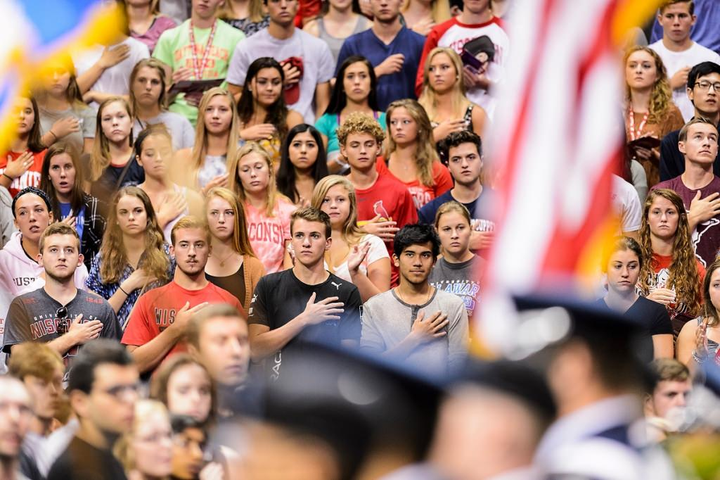 First-year students stand at attention for the singing of the national anthem at the start of the Chancellor's Convocation on Sept. 2.