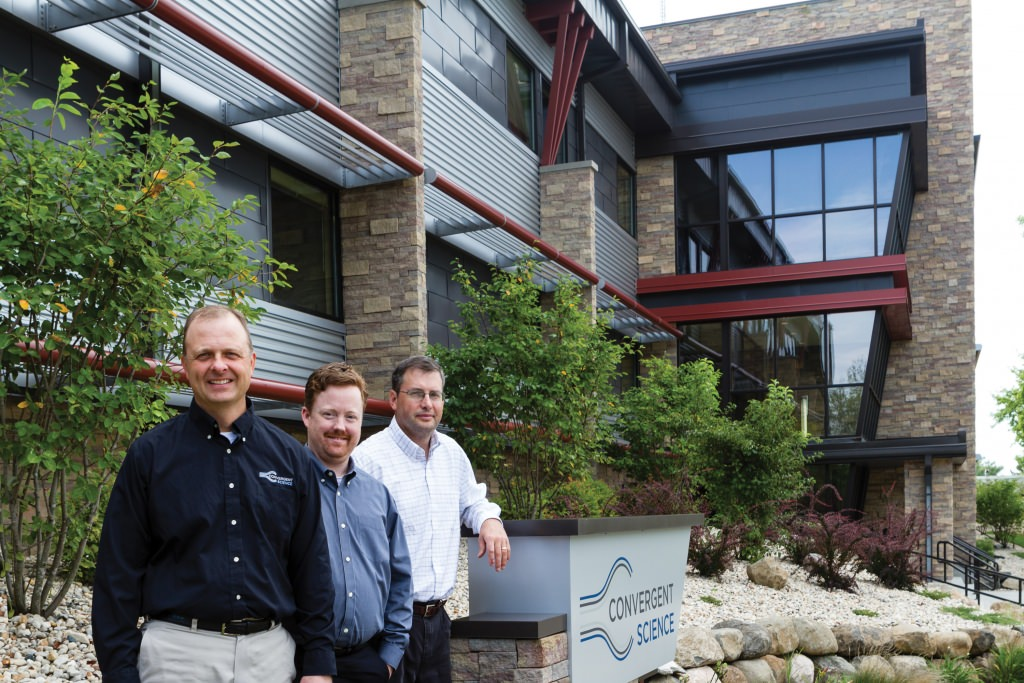 Three of the co-founders of Convergent Science, a UW–Madison spinoff that makes advanced engine-design software, at the company's Madison headquarters. From left: Eric Pomraning, Kelly Senecal and Keith Richards.