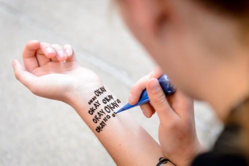 """Photo: Lucy Hodkiewicz with henna tatto saying """"Okay okay okay ..."""""""