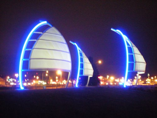 Photo: Neon sculpture of sails at the entrance to Monona