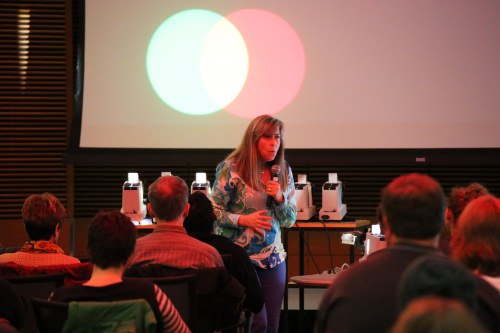 "Photo: Pupa Gilbert, a professor of physics at UW–Madison, presents the physics of color at the Nerd Nite event during the 2015 Wisconsin Science Festival. At the 2016 festival, Nerd Nite is a partner in the ""Science Storytellers Jam!"" that aims to engage audiences in science through creative storytelling."