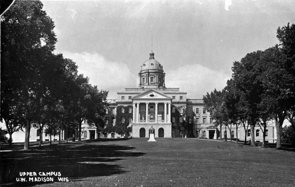 Bascom around 1910, four years after the north wing was completed. Elm trees line the walkways on Bascom Hill, including one (third from left) felled June 29, 2001 to prevent the spread of Dutch elm disease.