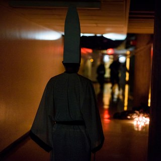A Chinese deity known as Heibai Wuchang, who escorts spirits of the dead to the underworld, roams the halls.