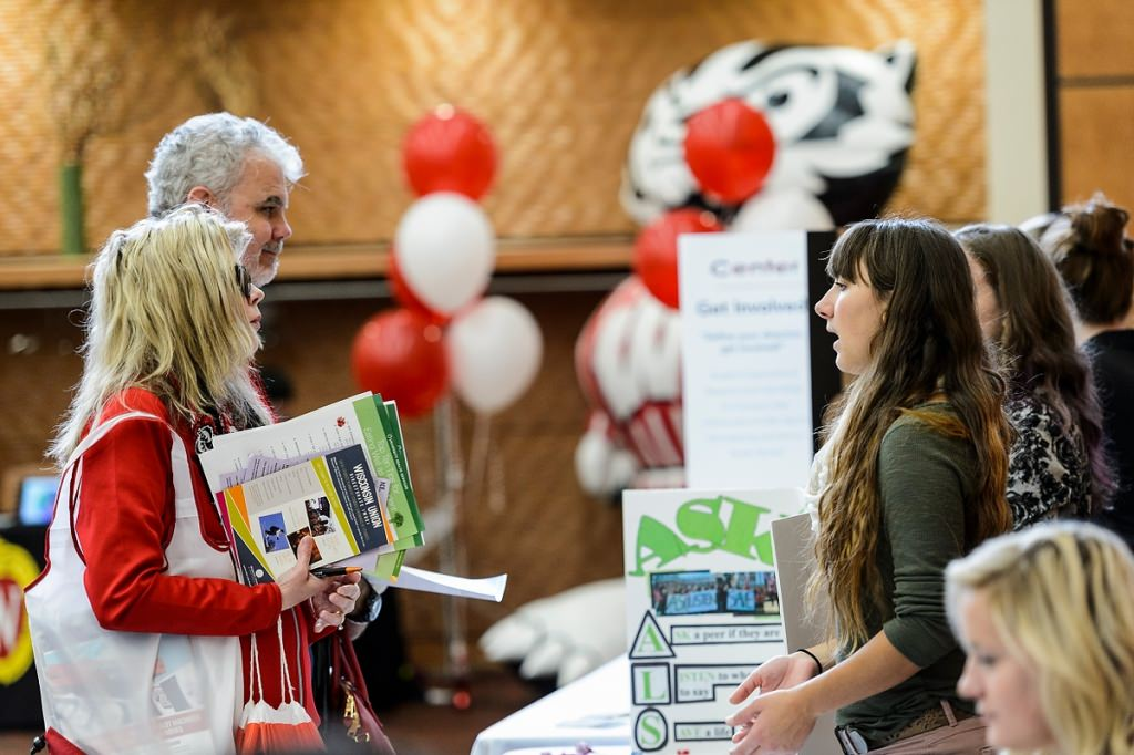 Badger parents take part in a Family Weekend resource fair Friday at the Gordon Dining and Event Center. Hosted by the UW-Madison Parent Program, the three-day event provides families of current students with a range of activities to experience and explore the campus.