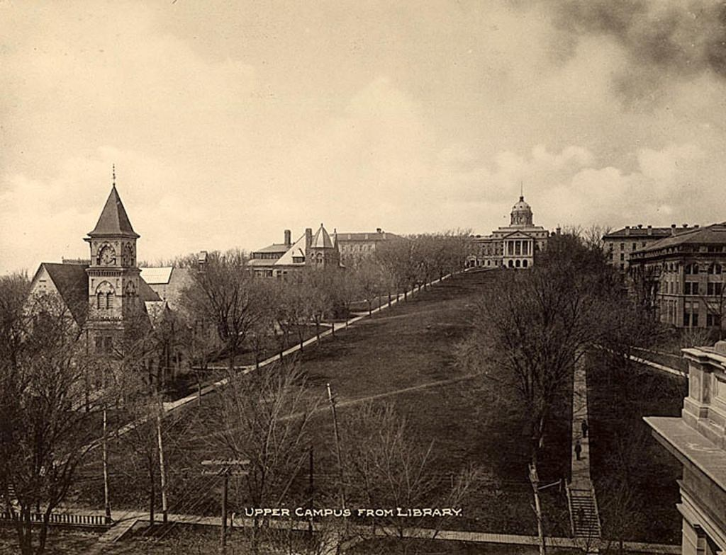A view up Bascom Hill, taken not long before the dome burned in 1916. The photo is taken from what is currently the Wisconsin Historical Society building. That building originally housed both the State Historical Library and the University Library, until Memorial Library was built in 1950.