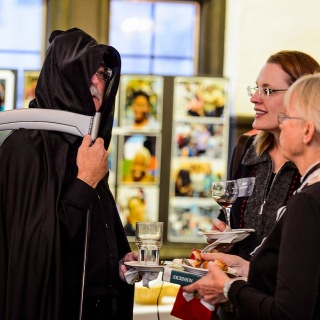 Dressed as the Grim Reaper, Don Miner, a friend of the Odyssey Project, mingles with guests at Night of the Living Humanities Thursday at the University Club.