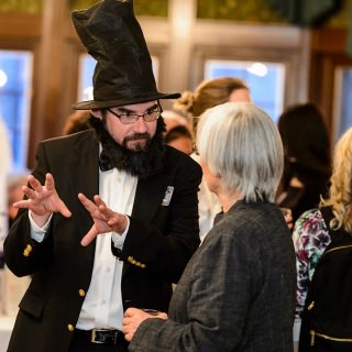Dressed as President Abraham Lincoln, Kevin Mullen, assistant director of Odyssey, speaks with guest Cindy Poe.