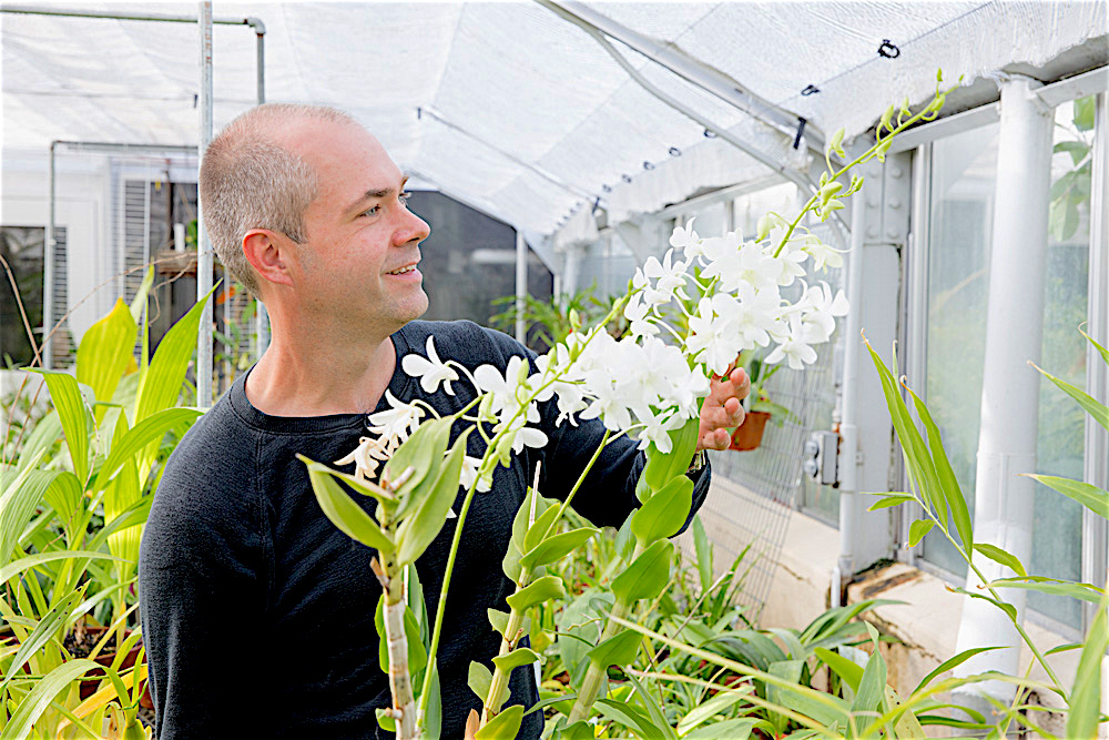 Photo: Steve Karlen with orchid plant