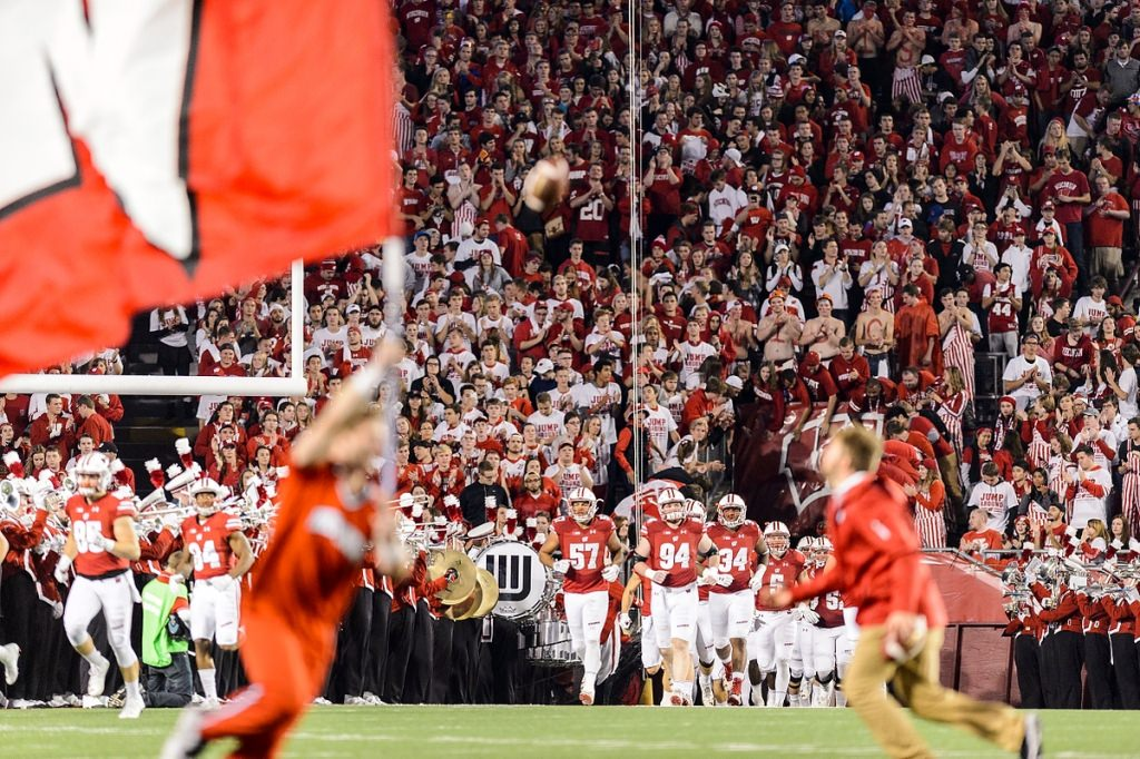 The Wisconsin Badgers come out for the second half of play in a night football game against the Ohio State University (OSU) Buckeyes.