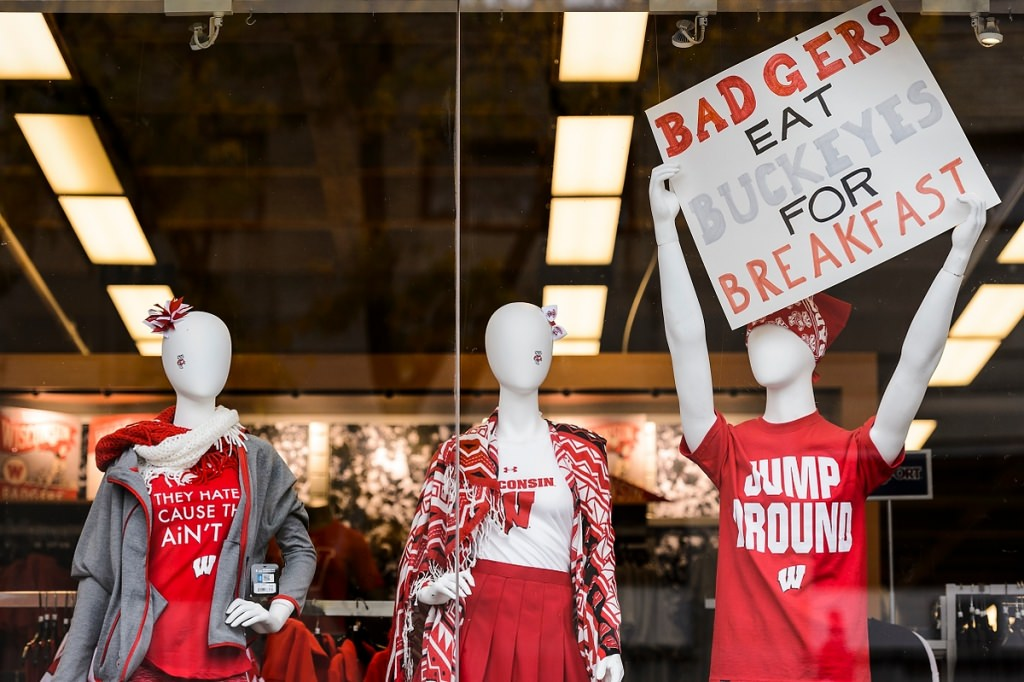 Wisconsin-themed attire and signs are displayed in a University Book Store window before the start of the Badgers' game against Ohio State University.