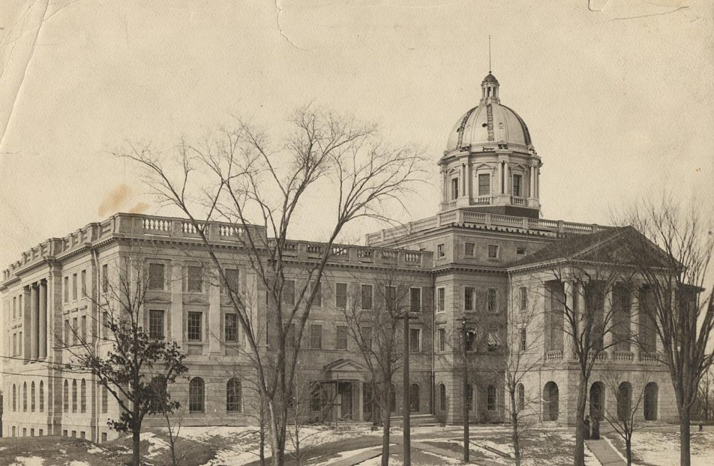 A new dome was built in 1898, and the south wing was completed in 1899; both are visible in this photo.